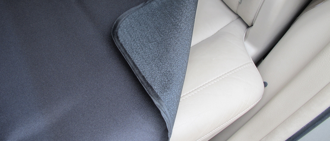 ARIES Seat Defender™ temporary seat cover with dual-layer protection
