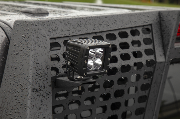 ARIES Switchback® aluminum headache rack with LED light in the rain
