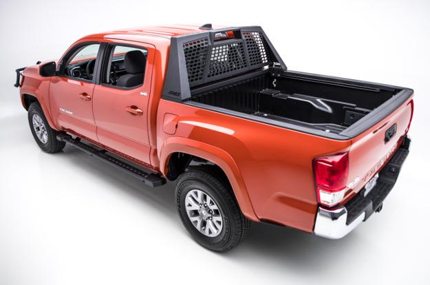 Custom red 2017 Toyota Tacoma with ARIES Switchback® headache rack