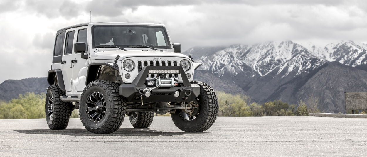 White 2016 Jeep Wrangler JK Unlimited with ARIES TrailChaser® bumper - mountains
