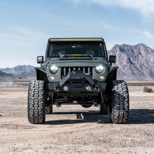 2016 Jeep Wrangler JK Unlimited in desert mountains with ARIES TrailCrusher® Jeep bumper