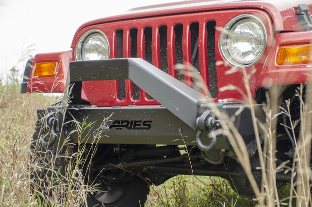 ARIES TrailCrusher® Jeep bumper on red 1999 Jeep Wrangler TJ