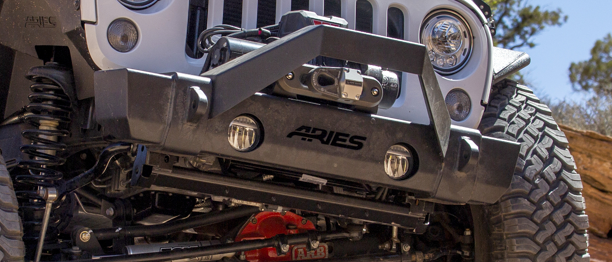 ARIES TrailCrusher® Jeep bumper with winch and shackle mounts on offroad Jeep Wrangler
