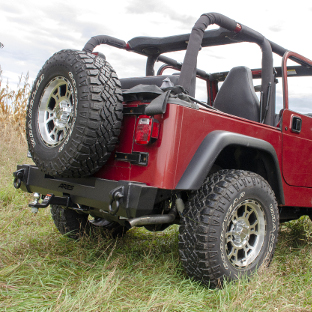 Red 1999 Jeep Wrangler TJ with ARIES TrailCrusher® rear Jeep bumper