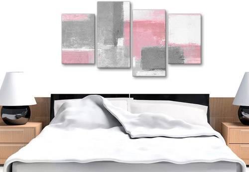 Quadri moderni con pennellate di colore rosa e grigio sopra testata letto