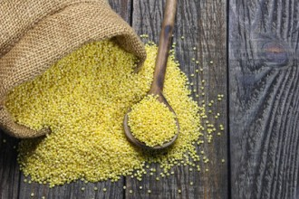 Raw millet on a wooden table