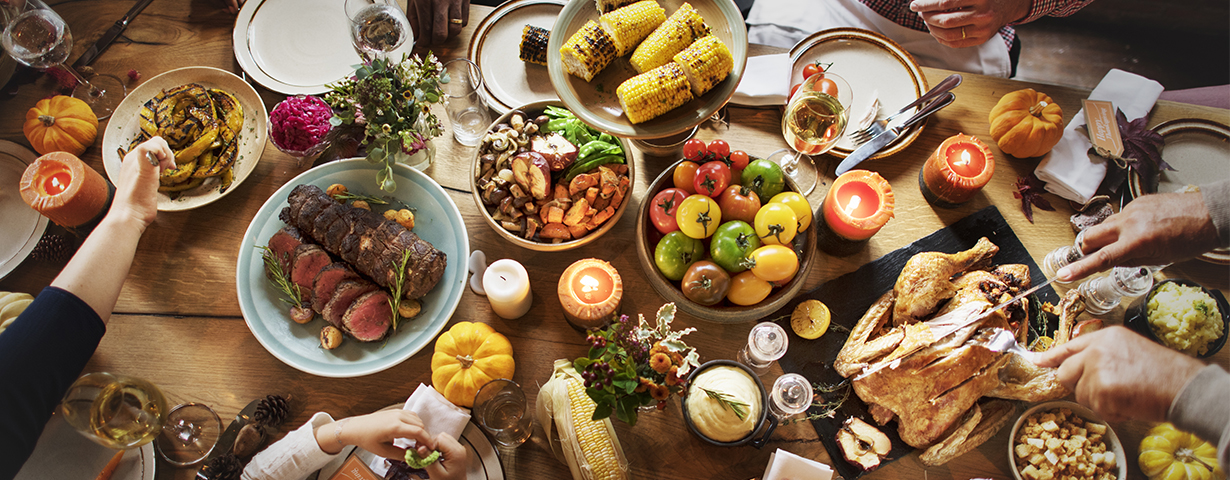 thanksgiving holiday meal on table with turkey corn vegetables