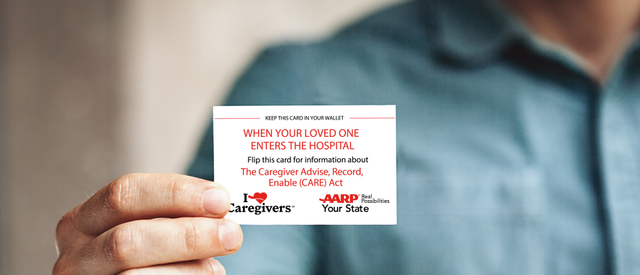 man holding up card offering information about caregiver advise record enable (CARE) Act AARP