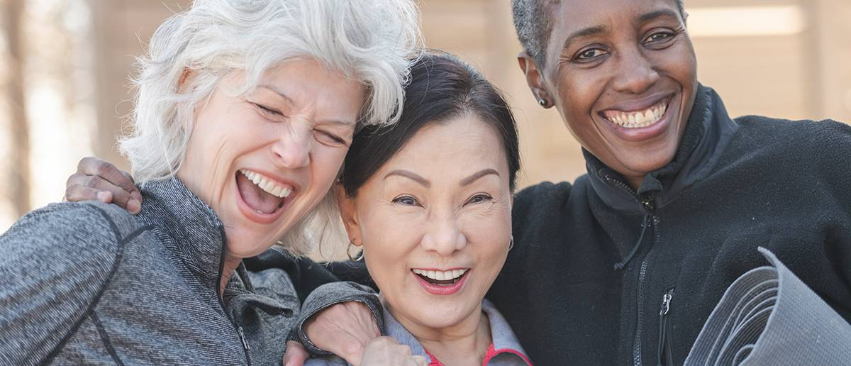 a group of senior women smiling and laughing