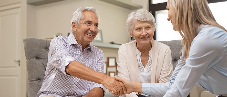 Elderly couple visiting a senior living community