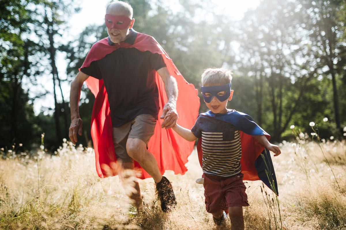 Grandfather and grandson dressed up as superheros