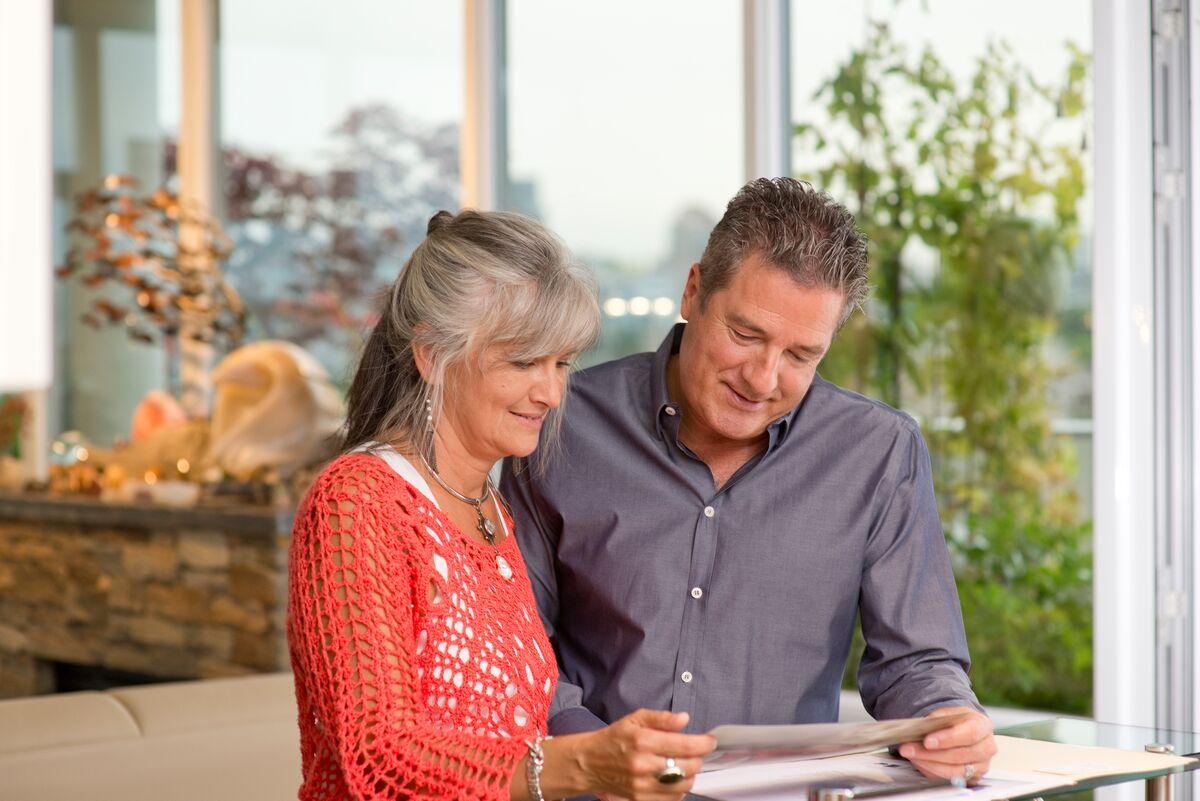 Senior couple looking at paperwork