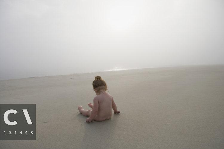 girl naked sitting beach on
