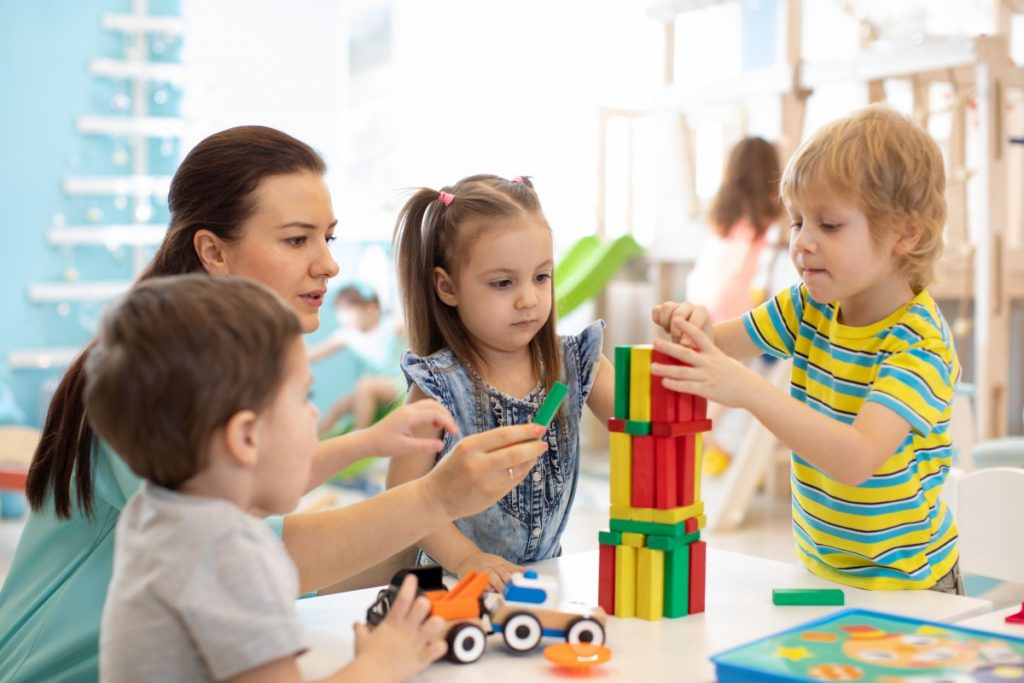 preschooler development playing with blocks