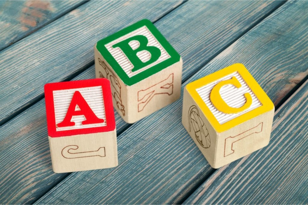 learn pre-k literacy with wooden block