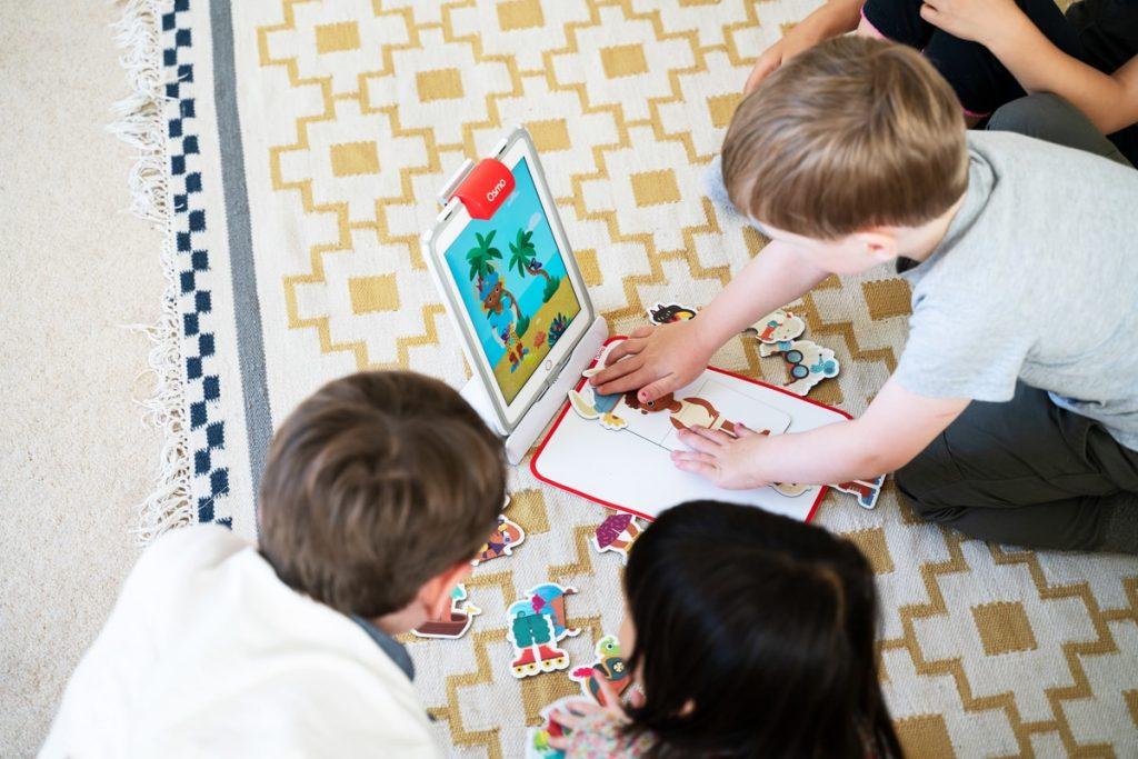 children playing osmo little genius starter kit on ipad