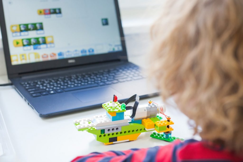Kids playing coding games