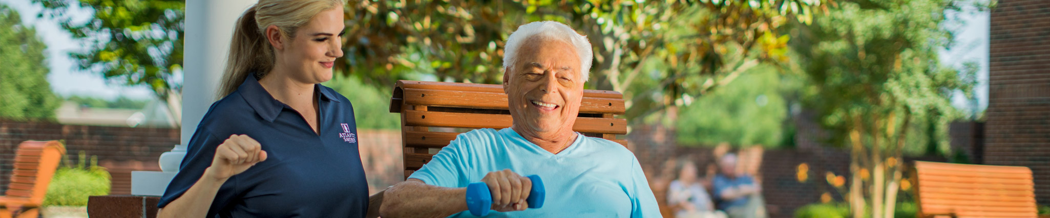 senior doing physical therapy with a physical therapist at a senior living community