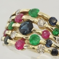 Remarkable Diamond Ruby Sapphire & Emerald Yellow Gold Band