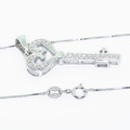 Magnificent Ladies 10K White Gold Diamond Heart Shaped Key Pendant