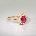 Elegant Ladies 10K Yellow Gold Oval Ruby Flower  Style Ring