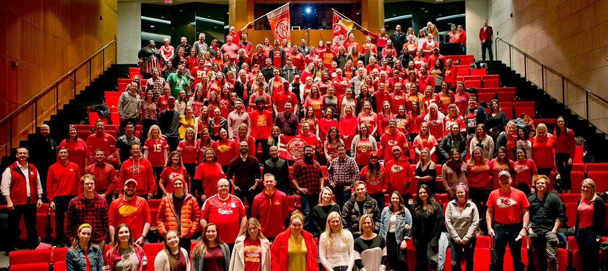 The Kansas City Attane team dressed in Chiefs gear during an annual meeting