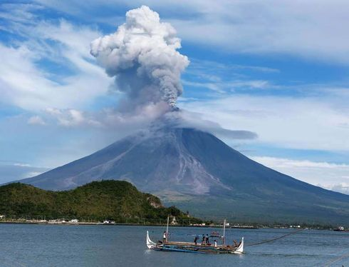 A volcano erupted on the Indonesian holiday island of Bali, causing some overnight flight cancellations to and from Australia as an ash cloud rose into the sky, officials said on Saturday.  Mount Agung volcano spewed out lava and showers of rocks over a distance of about 3 km (2 miles), with ash falling over dozens of villages, officials said. There were no reports of casualties.  Flights, run by Qantas Airways, JetStar and Virgin Airlines, were operating normally on Saturday.  Authorities had 50,000 masks available as a precaution though the alert level on the volcano remained unchanged and there had been no evacuations.  Photographs of Agung overnight showed an ash column and glowing lava in the crater of the volcano, which rises majestically over eastern Bali at a height of just over 3,000 metres.  In late 2017, authorities raised the alert level on Agung after a spike in activity, triggering evacuations and travel chaos at the time. The alert level has since been lowered but the rumbling Agung has erupted intermittently since then occasionally disrupting flights.  A major eruption in 1963 killed more than 1,000 people and razed several villages  Bali, famous for its surf, beaches and temples, attracts around 5 million visitors a year.     Source: https://www.msn.com/en-us/news/world/volcano-erupts-on-indonesias-bali-causing-flight-cancellations/ar-AABTBdd