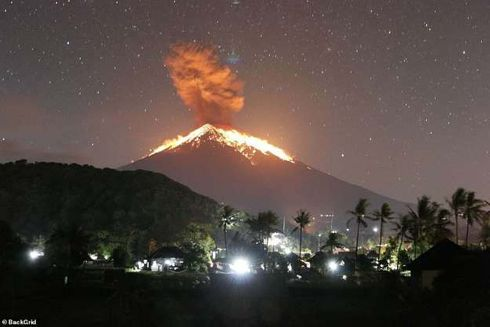 Bali's Mount Agung volcano erupted on Friday, spreading ash across the Indonesian island and forcing flights in and out of the airport to be cancelled.  The eruption happened on Friday night and lasted four minutes and 30 seconds, lava was seen spurting out of the crater and down the slope for three kilometres.  The Directorate General of Air Transportation said four flights to Bali were diverted and five flights out of the popular tourist destination were canceled because of volcanic ash.  Volcanic ash rained and affected villages in the nearby regions of Karangasem and Bangli, the Sydney Morning Herald reported.  No immediate evacuation was called as the villages are well within the safe zone, a spokesperson for the National Disaster Mitigation Agency told the publication.   Indonesia's Center of Volcanology and Geological Disaster Mitigation (PVMBG) said in a repor t: 'The ash column could not be observed.  'Thundering sounds from the eruption were heard adequately strong from the monitoring post.'  Agung became active again in 2017 after more than a half century of slumber following a major eruption in 1963.   This is the third time the volcano has erupted this month, with the other two incidents happening on May 12 and May 18.   Source: https://www.msn.com/en-us/news/weather/balis-mount-agung-erupts-and-spews-lava-as-volcanic-ash-spreads-across-the-sky-forcing-all-flights-in-and-out-of-the-island-to-be-cancelled/ar-AABRS0s