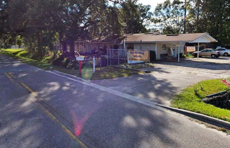 """A baby died Wednesday after she was left in a van for almost five hours outside a Florida day care, authorities said, and the director of the day care has been arrested.  The infant girl was discovered in a van at Ewing's Love & Hope Preschool and Academy in Jacksonville. The director and co-owner of the day care, Darryl Ewing, was arrested Wednesday night on a child neglect charge, according to the Jacksonville Sheriff's Office.  The day care's license was temporarily suspended Wednesday because it had not notified the state that it was transporting children, the Florida Department of Children and Families (DCF) said in a statement provided to NBC affiliate WTLV in Jacksonville.  The state agency said it had opened a joint child death and child care licensing investigation in coordination with law enforcement.  """"Every day, parents entrust child care providers with their most precious gifts,"""" DCF Secretary Chad Poppell said in the statement. """"Tragically, today a family has just been notified of the gut-wrenching loss of their precious baby girl.""""  Authorities said the child, whose identity has not been released, was only a few months old.  The Jacksonville County Sheriff's Office was dispatched to the preschool at 1:08 p.m. to assist the Jacksonville Fire and Rescue Department. Upon arrival, authorities found the child was not breathing and attempted to resuscitate her.  She was taken to the hospital where she was declared dead.  """"Preliminary information suggests that the kid was there from about 8 a.m. to about a little after 1 p.m.,"""" Asst. Chief Brian Kee told reporters at a news conference Wednesday. """"Almost five hours.""""  Kee said the exact cause of death is still being investigated, but it is believed to be heat related.  The day care typically transports some children to its facility, he said.  Kee said officers are interviewing """"those involved"""" and will coordinate with the state attorney's office to determine the appropriate charges to file.   Source: https://"""