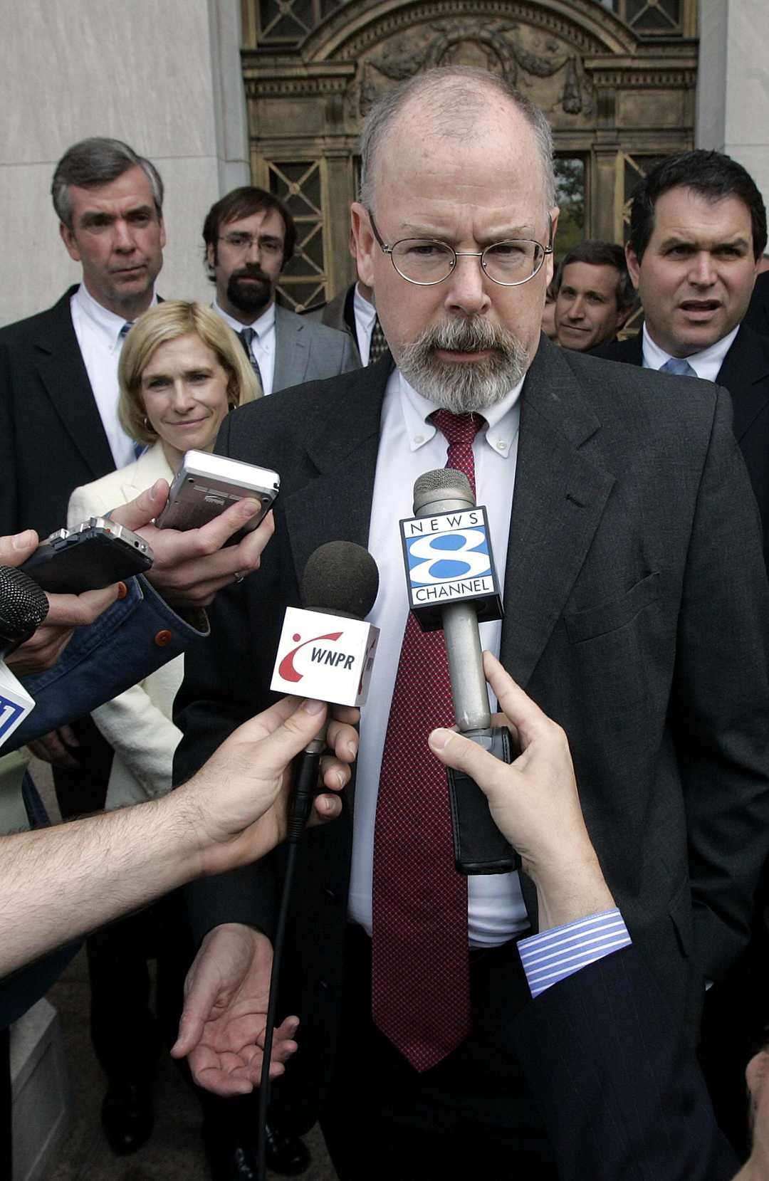 """Attorney General William Barr tapped Connecticut's chief federal prosecutor, John Durham, to assist in an investigation into the origins of the Russia investigation and the FBI's surveillance activities, a person familiar with the matter said Monday.  The person, who is not authorized to comment publicly, said that Durham has been assisting the attorney general for at least a couple of weeks to determine whether federal investigators acted appropriately in the early stages of the now-completed inquiry into Russia's interference in the 2016 election.  Barr announced that he had launched the review last month during an appearance before a Senate subcommittee. He expressed concern about the FBI's use of surveillance involving associates of then-candidate Donald Trump as authorities sought to understand Russia's interference efforts, though Barr also said he did not know whether officials had done anything wrong.  """"Spying on a campaign is a big deal,"""" Barr told lawmakers then. """"I think spying did occur. The question is whether it was adequately predicated.""""  At that time, the attorney general said he planned to examine the """"genesis and the conduct"""" of the FBI's investigation into possible ties between the Trump campaign and Russia.  """"I am not saying that improper surveillance occurred,"""" Barr told the Senate Appropriations subcommittee. """"I am concerned about it. There is a basis for my concern.""""   Democrats have seized on Barr's use of the term """"spying,"""" asserting that the attorney general has sided with President Trump to disparage the 22-month investigation that the president has repeatedly described as a """"witch-hunt.""""  As recently as last week, however, FBI Director Christopher Wray said he was unaware of any evidence indicating that the FBI had abused its surveillance authority, distancing himself from the attorney general. """"That's not the term I would use,"""" Wray told the same Senate committee, referring to the """"spying"""" reference.  Rod Rosenstein, until recently the """