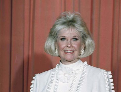 """Doris Day, the honey-voiced singer and actress whose film dramas, musicals and innocent sex comedies made her a top star in the 1950s and '60s and among the most popular screen actresses in history, has died. She was 97.  The Doris Day Animal Foundation confirmed Day died early Monday at her Carmel Valley, California, home. The foundation said she was surrounded by close friends.  """"Day had been in excellent physical health for her age, until recently contracting a serious case of pneumonia, resulting in her death,"""" the foundation said in an emailed statement.  With her lilting contralto, wholesome blonde beauty and glowing smile, she was a top box office draw and recording artist known for such films as """"Pillow Talk"""" and """"That Touch of Mink"""" and for such songs as """"Whatever Will Be, Will Be (Que Sera, Sera)"""" from the Alfred Hitchcock film """"The Man Who Knew Too Much.""""  But over time, she became more than a name above the title: Right down to her cheerful, alliterative stage name, she stood for a time of innocence and G-rated love, a parallel world to her contemporary Marilyn Monroe. The running joke, attributed to both Groucho Marx and actor-composer Oscar Levant, was that they had known Day """"before she was a virgin.""""  Day herself was no Doris Day, by choice and by hard luck.  In """"Pillow Talk,"""" released in 1959 and her first of three films with Rock Hudson, she proudly caught up with what she called """"the contemporary in me."""" Her 1976 tell-all book, """"Doris Day: Her Own Story,"""" chronicled her money troubles and three failed marriages, contrasting with the happy publicity of her Hollywood career.  """"I have the unfortunate reputation of being Miss Goody Two-Shoes, America's Virgin, and all that, so I'm afraid it's going to shock some people for me to say this, but I staunchly believe no two people should get married until they have lived together,"""" she wrote.  She never won an Academy Award, but Day was given a Presidential Medal of Freedom in 2004, as George W. Bush decla"""