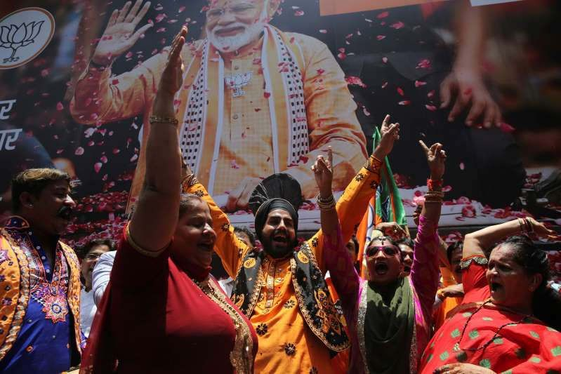 """Indian Prime Minister Narendra Modi's party claimed it had won reelection with a commanding lead in Thursday's vote count, while the stock market soared in anticipation of another five-year term for the pro-business Hindu nationalist leader.  Election Commission data by midafternoon showed the Bharatiya Janata Party leading in contests for 299 out of 542 seats in the lower house of Parliament, with its main rival, the Indian National Congress, ahead in 50 contests.  The data didn't indicate what percentage of the estimated 600 million votes cast over the six-week election had been counted. Although the final tally was not expected until Thursday evening at the earliest, BJP President Amit Shah claimed a victory, crediting Modi's """"leadership.""""  Modi himself tweeted: """"India wins yet again.""""  The election has been seen as a referendum on India's 68-year-old prime minister, whose economic reforms have had mixed results but whose popularity as a social underdog in India's highly stratified society has endured. Critics have said his Hindu-first platform risks exacerbating social tensions in the country of 1.3 billion people.  On the campaign trail, Modi presented himself as a self-made man with the confidence to cut red tape and unleash India's economic potential, and labeled Congress party president Rahul Gandhi, the scion of a political dynasty that lost power in 2014, as an out-of-touch elite.  The BJP's performance """"is absolutely stunning. Modi is the predominant leader in India today. He has pushed everybody else aside. Nobody in the opposition is a match for him,"""" said political commentator Arti Jerath.  Half a dozen exit polls released after voting concluded Sunday showed Modi and the Bharatiya Janata Party winning. A party or coalition needs a simple majority of 272 seats, or just over half the seats in Parliament's lower house, to govern.  """"Mr. Modi's going to be the next prime minister, we are very assured of that,"""" said Meenakshi Lekhi, a member of Parliament r"""