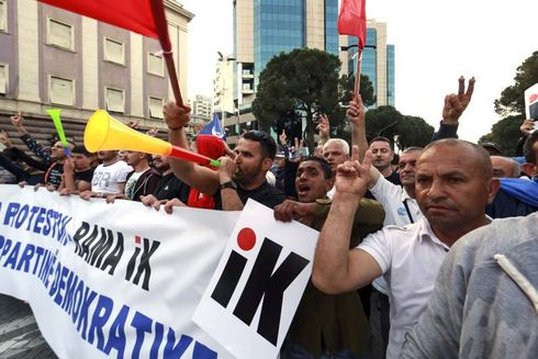 """Albanian opposition supporters marched in another anti-government protest Saturday to demand the prime minister's resignation as the European Union and the U.S. warned them to avoid violence and to hold talks instead to resolve the country's political deadlock.  Protesters gathered from around the country in Tirana, the capital, waving national and EU flags, shouting """"Rama Go!"""" and blowing vuvuzelas.  Some protesters threw flares, smoke bombs and other projectiles and police responded with water cannon. Opposition leaders were seen trying to stop those hurling stones at police.  The center-right Democratic Party-led protests, which have been going on since mid-February, have often turned violent. A statement from the EU office in Tirana condemned the past violence, urging all sides to hold talks to find """"a way out of the current political situation.""""  The United States embassy in Tirana also urged all sides """"to practice restraint, disavow violence and engage in constructive dialogue.""""  The opposition has declined to talk with Rama unless he resigns. It accuses his Cabinet of corruption and links to organized crime. The governing Socialists deny those claims and say the violent opposition protests are hurting the country's image.  The Democrats leader, Lulzim Basha, said Saturday that Rama's resignation was """"the only way to open the dialogue."""" He then led his supporters in a march toward the Parliament building with lit cellphones held high.  The opposition is boycotting Albania's June 30 municipal election.  In June, Albania expects the EU to grant its request to launch full membership negotiations.  Source: https://www.msn.com/en-gb/news/world/eu-us-urge-non-violence-as-albanian-opposition-protests/ar-AABU4i3"""