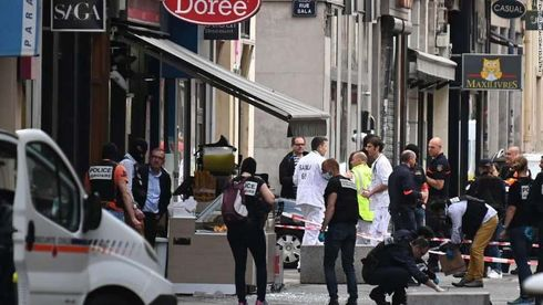 """At least 13 people were hurt Friday in an explosion in the French city of Lyon, prompting a national investigation into possible terrorism.  The blast occurred in the early evening in the city's central shopping area. Eleven of the 13 injured were taken to hospital, including a 10-year-old child, the Paris Prosecutor's office said Saturday.  French police are still looking for the person suspected of carrying out the attack, according to a tweet from the French National Police verified Twitter account. Police also tweeted a photo of the man they believed to be """"the author of the attack"""" and asked the public to call with any information.  French President Emmanuel Macron characterized the blast as an attack shortly after it happened, telling an interviewer: """"I'm late because there was an attack in Lyon.""""  Investigators believe the explosion may have been caused by a parcel bomb packed with nails, a spokeswoman for the city prosecutor told CNN.  The city's second district mayor, Denis Broliquier, said on French television channel BFMTV that overall damage was not severe because """"the load of the parcel bomb"""" did not cause much of an impact. Victims' wounds, he added, were caused by """"pieces of metal and glass.""""  An investigation into """"terrorist conspiracy"""" has been opened, French Justice Minister Nicole Belloubet announced hours after the explosion.  Hanane Benakkouche, a waitress at the nearby restaurant L'espace Brasserie, told CNN of the moment the blast went off.  """"We heard an explosion. I was working on the terrace and people started running, leaving Victor Hugo Street,"""" she recalled. """"Policemen arrived quickly on the scene. I'm still shocked.""""  The evacuated scene was visible in photos tweeted by the regional police of Auvergne-Rhone-Alpes, which asked the public to avoid the area.  Emergency responders were assisting the wounded, a spokesperson for the Police Nationale told CNN, adding that the priority would be assisting victims """"regardless of if it was a car cr"""
