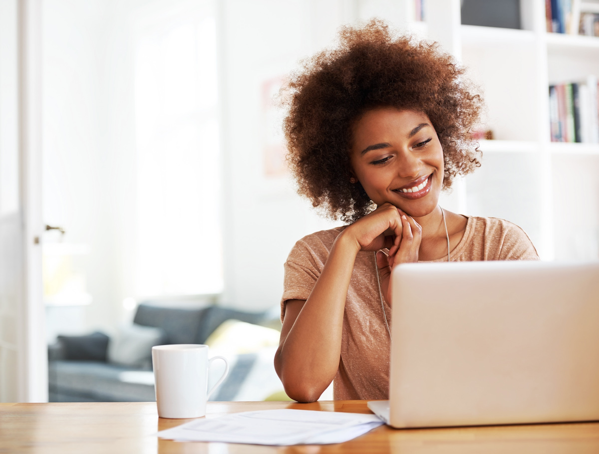 Woman looking thoroughly pleased with her work-from-Anywhere proposal