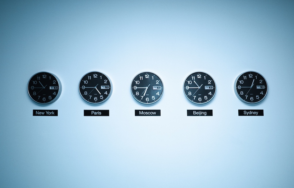 Clocks on wall for working across time zones in a distributed team