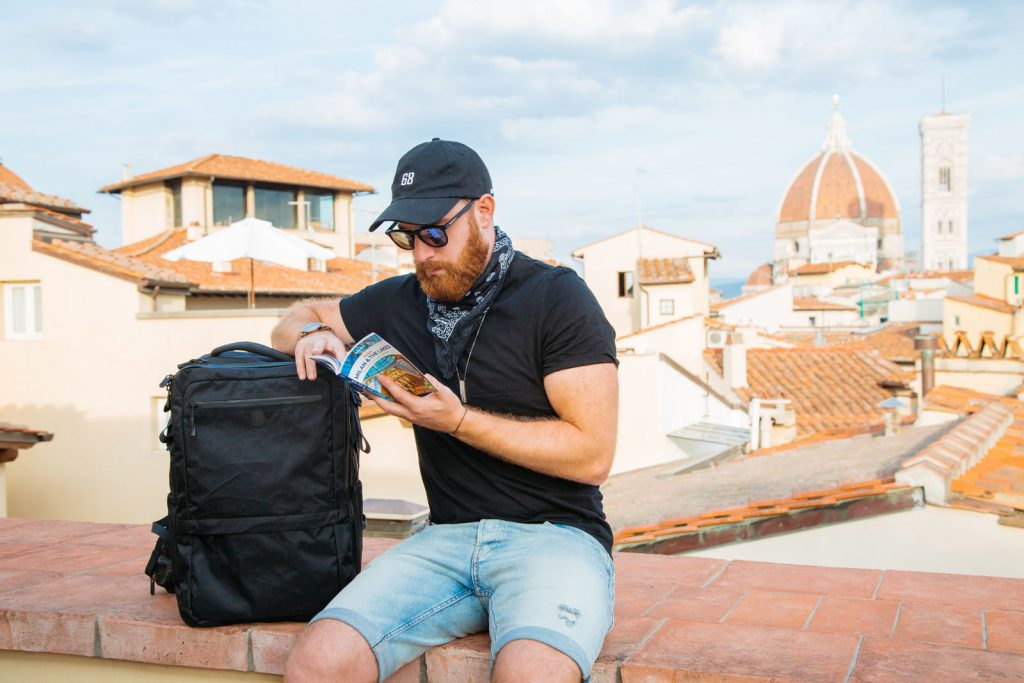 Man trravelling and working Anywhere with Tortuga backpack