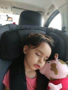 Elisa in her Axkid car seat