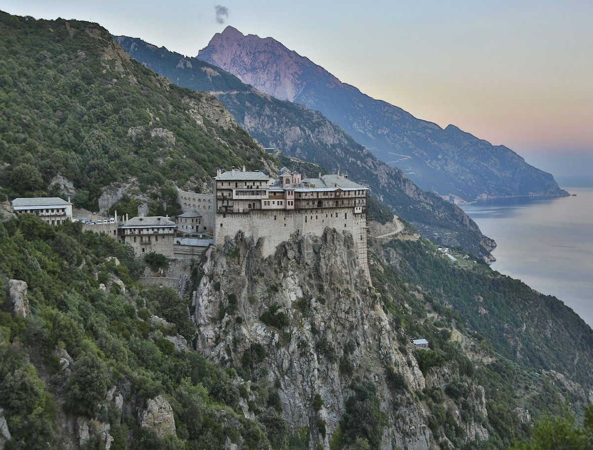 Stunning view of a monastary built in to the side of a mountain in Agion Oros (Mount Athos)