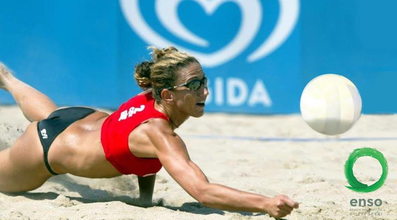 Efi Sfyri diving on sand to return beach volleyball