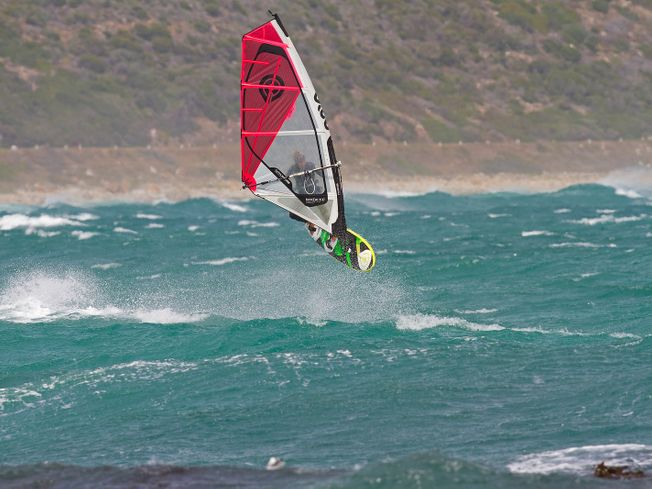 Tony Frey performing windsurfing stunt and getting air