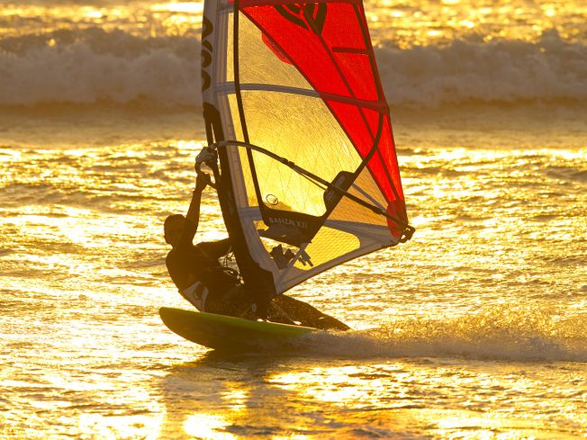 Tony Frey windsurfing as the sun sets