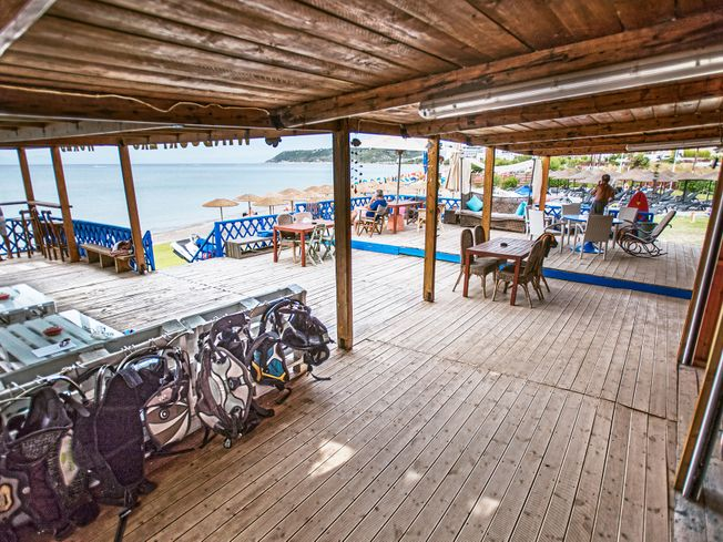 Windsurf Center in Rhodes with decking for tables and chairs in front of the sea