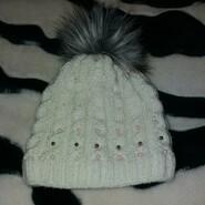 Зимова шапка для дівчинки на 5-7 років