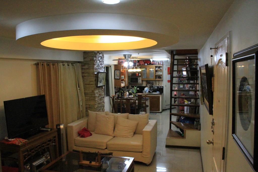 living room of a 4-bedroom condo in Manila