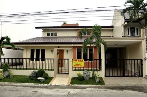 Own this brand new (entirely renovated) Modern Tropical Beauty.  Lot Area 280sqm, Floor Area 300sqm.  1 1/2 storey.  4 bedrooms, 3 bathrooms, upstairs terrace, balcony, family room.  Includes a maids' rm w/ its own toilet and bath, and a 2-car garage.