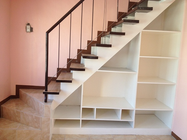 staircase with metal handrailings
