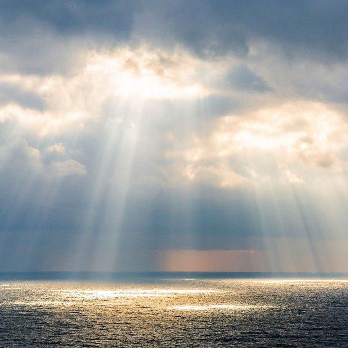 Minnesgåva Sol genom moln Förhandsvisning.jpg