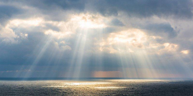 Minnesgåva Sol genom moln.jpg