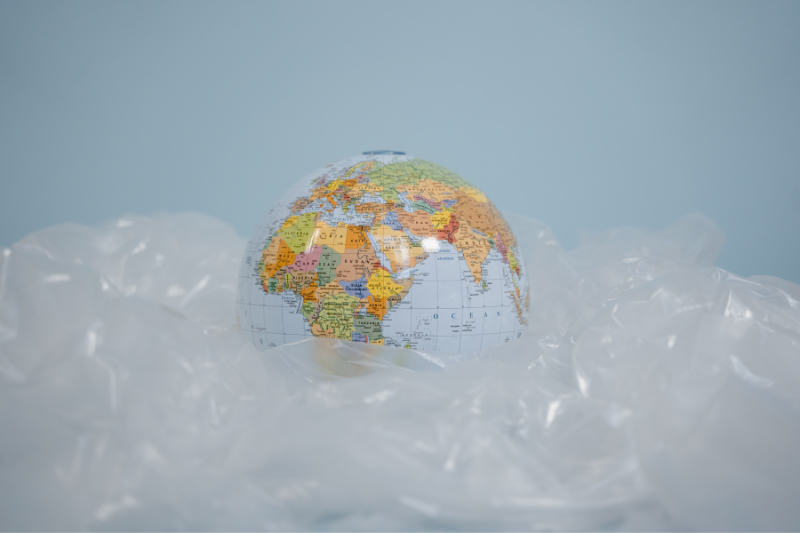 A Globe Surrounded By Plastic